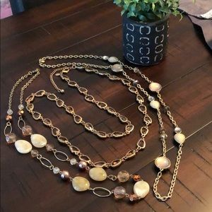 Layering necklaces mixed metals and neutrals
